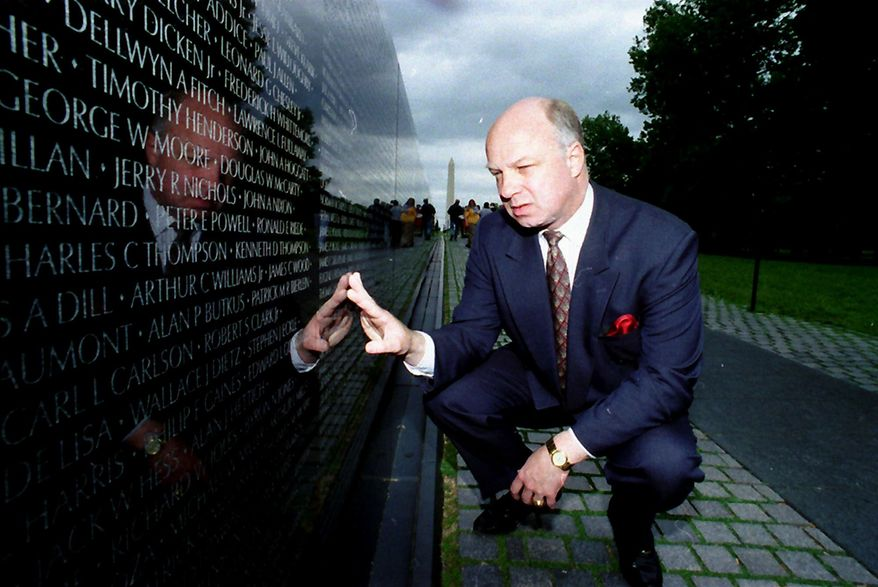 "John ""Jack"" Wheeler III, here in 1994, finds the name of a friend engraved in the Vietnam Veterans Memorial in Washington. Wheeler's body was discovered Dec. 31. It had been left in a trash bin in Newark, Del. His death has been ruled a homicide. (Associated Press)"