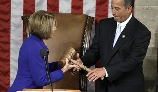 Incoming House Speaker John A. Boehner, Ohio Republican, receives the gavel from his predecessor, Rep. Nancy Pelosi, California Democrat, during the opening session of the 112th Congress on Wednesday, Jan. 5, 2011, on Capitol Hill in Washington. (AP Photo/Charles Dharapak)