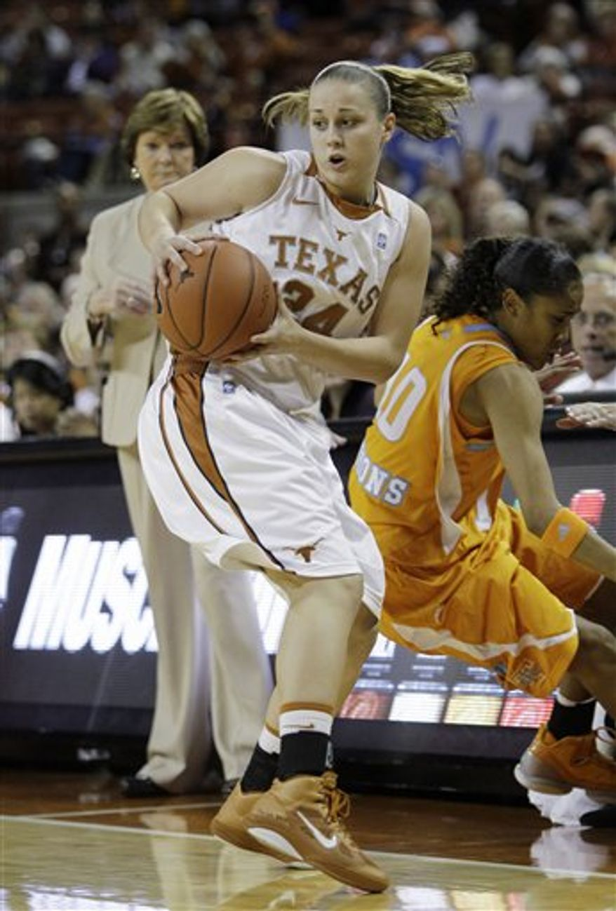 FILE - In this Dec. 12, 2010, file photo, Texas' Chassidy Fussell (24) keeps the ball from Tennessee's Meighan Simmons (10) during the first half of an NCAA college basketball game in Austin, Texas. Freshmen are making a sudden impact in Big 12 women's basketball. Oklahoma's Aaryn Ellenburg, Texas' Chassidy Fussell and Nebraska's Jordan Hooper are among the top 10 scorers in the league, and three other freshmen are among the top 30.(AP Photo/Eric Gay, File)
