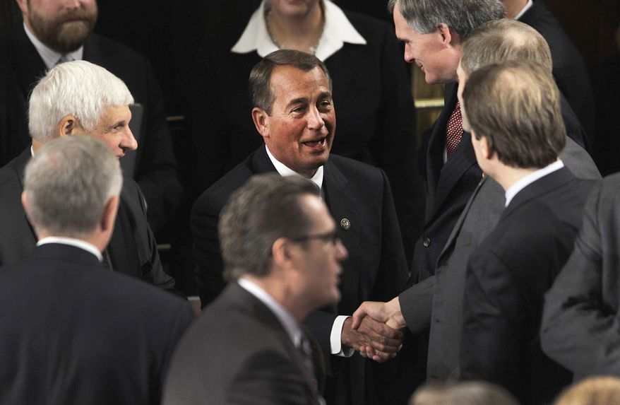 Rep. John A. Boehner, Ohio Republican, who is speaker-designate, greets fellow House members during the first session of the 112th Congress on Capitol Hill in Washington on Wednesday, Jan. 5, 2011. (AP Photo/Charles Dharapak)