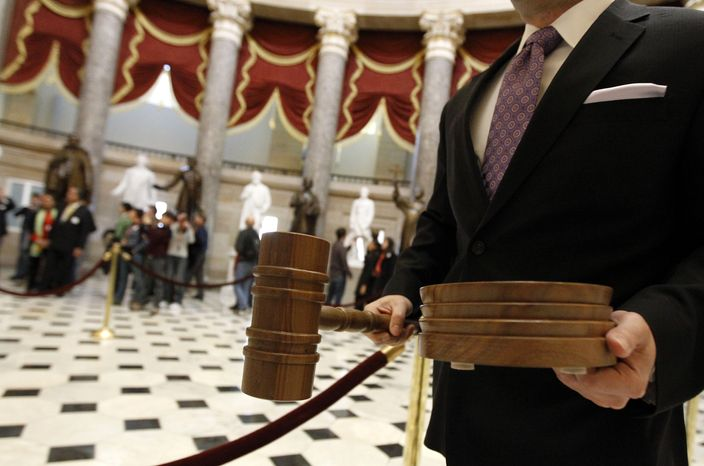 The gavel and sound block for House Speaker-designate John A. Boehner, Ohio Republican, is carried through Statuary Hall to the floor of the House of Representatives on Capitol Hill in Washington on Wednesday, Jan. 5, 2011. (AP Photo/Alex Brandon)