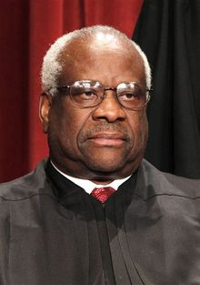 "FILE - In this Oct. 8, 2010 file photo, Associate Justice Clarence Thomas is seen during the group portrait at the Supreme Court Building in Washington. Lillian McEwen, who dated Thomas in the 1980s, has signed with TitleTown Publishing for her book titled, ""D.C. Unmasked and Undressed,"" TitleTown announced Tuesday, Jan. 4, 2011.  The book is scheduled for release in February. (AP Photo/Pablo Martinez Monsivais, file)"