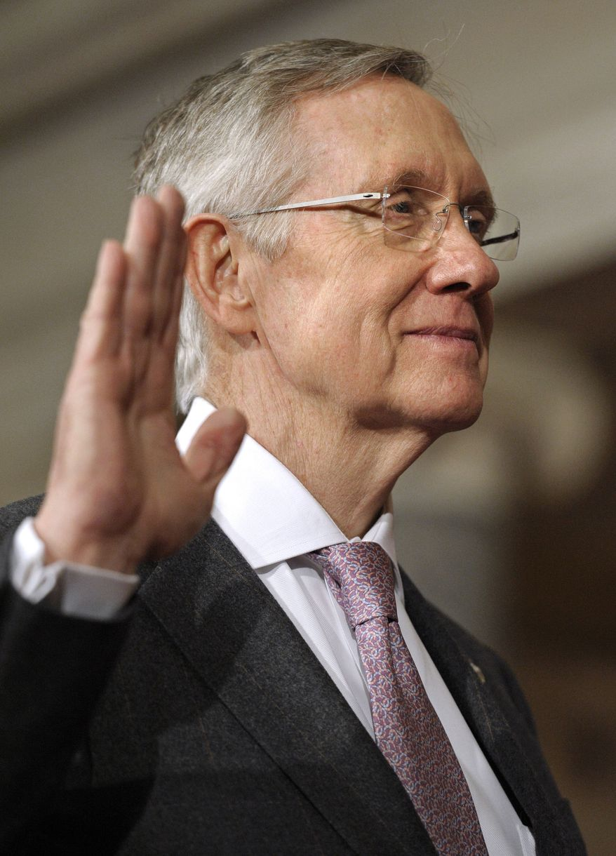 Senate Majority Leader Harry Reid, Nevada Democrat, takes the Senate oath during a mock swearing-in ceremony on Capitol Hill in Washington on Wednesday, Jan. 5, 2011. (AP Photo/Cliff Owen)
