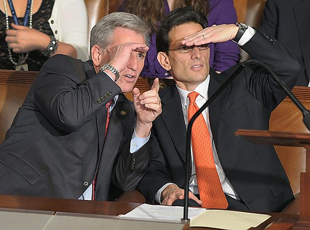 Incoming House Majority Leader Eric Cantor of Virginia, right, and incoming House Majority Whip Kevin McCarthy of California look across the House floor during the first session of the 112th Congress on Capitol Hill in Washington, Wednesday, Jan. 5, 2011.  (AP Photo/Susan Walsh)