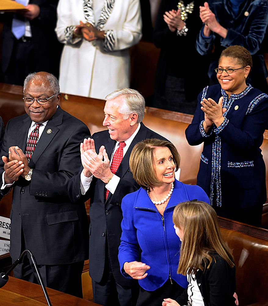 Outgoing House Speaker Nancy Pelosi of California reacts to the applause, on Capitol Hill in Washington, Wednesday, Jan. 5, 2011, during the first session of the 112th Congress. Assistant House Minority Leader-designate James Clyburn of South Carolina is at left, House Minority Whip-designate Steny Hoyer of Maryland is second from left. (AP Photo/Susan Walsh)