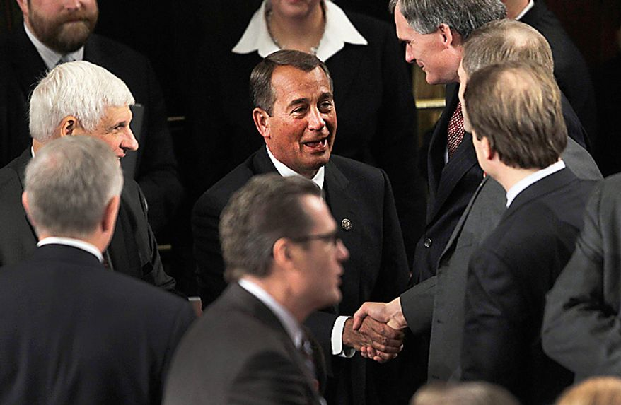 House Speaker-desigante John Boehner of Ohio greets House members during the first session of the 112th Congress, on Capitol Hill in Washington, Wednesday, Jan. 5, 2011.  (AP Photo/Charles Dharapak)