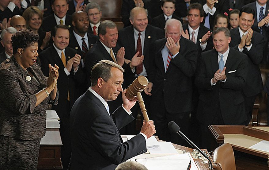 House Speaker John A. Boehner, Ohio Republican, holds up the gavel during the first session of the 112th Congress on Capitol Hill in Washington on Wednesday, Jan. 5, 2011. (AP Photo/Susan Walsh)