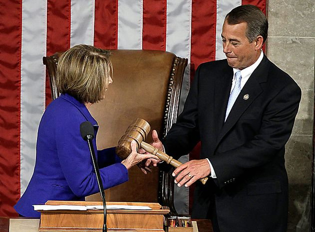 Outgoing House Speaker Nancy Pelosi of California hands the gavel to the new House Speaker John Boehner of Ohio during the first session of the 112th Congress, Wednesday, Jan. 5, 2011, on Capitol Hill in Washington.  (AP Photo/Charles Dharapak)