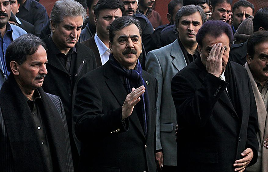 Pakistani Prime Minister Yousuf Raza Gilani, center, and Interior Minister Rehman Malik, right, arrive to attend the funeral of Punjab Gov. Salman Taseer in Lahore, Pakistan, on Wednesday, Jan. 5, 2011. Thousands of Pakistani police were on high alert in Lahore ahead of the funeral for the outspoken provincial governor shot dead allegedly by a bodyguard reportedly enraged by his opposition to laws decreeing death for insulting Islam. Mr. Taseer, a high-profile, 66-year-old businessman and media tycoon, was a stalwart of the ruling Pakistan People's Party, and his assassination Tuesday sent nuclear-armed Pakistan reeling at a time of great political turmoil. (AP Photo/K.M. Chaudary)