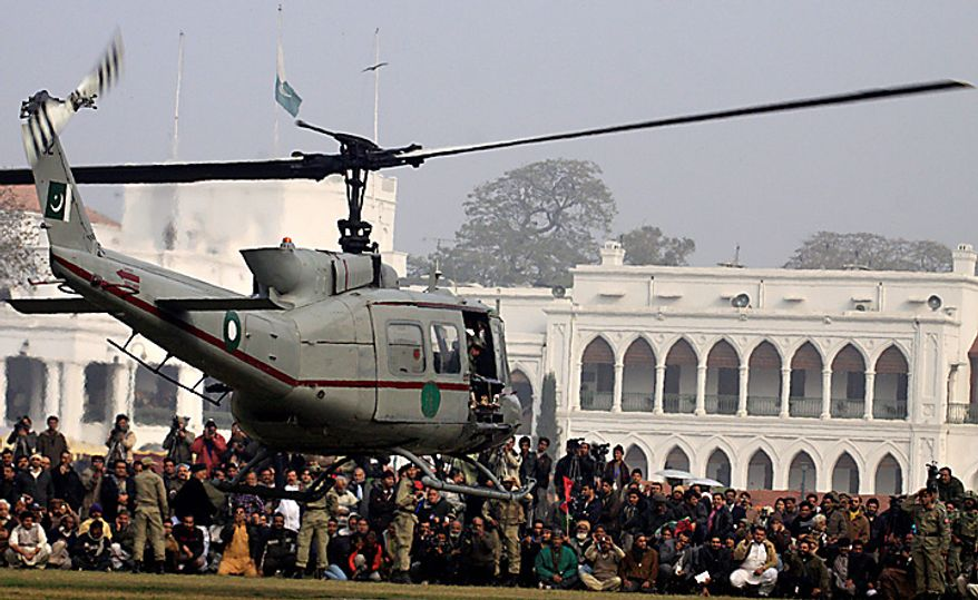 A Pakistani helicopter carrying the coffin of Punjab Gov. Salman Taseer departs for his burial in Lahore, Pakistan, on Wednesday, Jan. 5, 2011. (AP Photo/K.M. Chaudary)