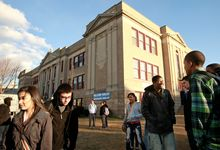 Students stand around outside Central Falls High School at the end of the school day. Just 7 percent of the 840-student school's 11th-graders tested as proficient in math in 2009. (Associated Press)