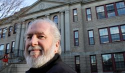English teacher Richard Kinslow does not call in sick at Central Falls High School in Central Falls, R.I., but many teachers have done so since being rehired in a second-chance agreement. The entire staff was fired last year in a radical improvement effort. (Associated Press)
