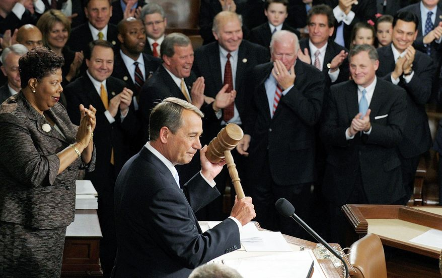 HAMMER TIME: Newly installed House Speaker John A. Boehner, Ohio Republican, displays the parliamentary gavel that he will wield in the 112th Congress, which convened Wednesday. (Associated Press)