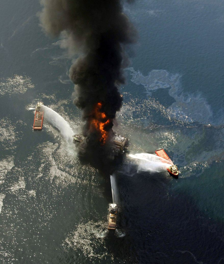 The Deepwater Horizon oil rig burns in April after exploding in the Gulf. A federal panel has concluded that decisions made to save time and money increased danger. (Associated Press)