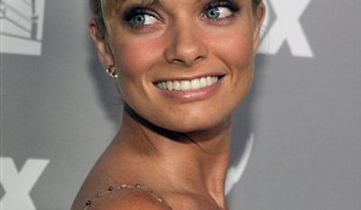 FILE - In this Aug. 27, 2006, file photo, actress Jaime Pressly poses for photographers as she arrives at the post-Emmy party in Beverly Hills, Calif. Santa Monica police say Pressly was arrested, Wednesday, Jan. 5, 2011, for investigation of driving under the influence of alcohol. (AP Photo/Jae C. Hong, file)