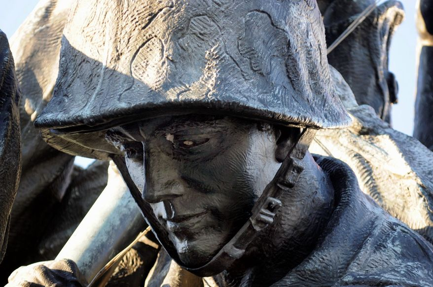 The face of a Marine, his face chipped in two places, shows the need for repair to the Iwo Jima memorial in Arlington, Va. (Rod Lamkey Jr./Special to The Washington Times)