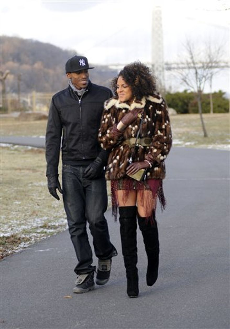 "In this Dec. 15, 2010 photo released by RCA Music Group, recording artist Marsha Ambrosius is shown during the filming of her music video for ""Far Away"" in Edgewater, New Jersey. (AP Photo/RCA Music Group, Fernando Leon)"