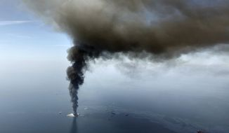 The Deepwater Horizon oil rig burns in the Gulf of Mexico on April 21, 2010. (AP Photo/Gerald Herbert)