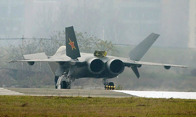 In this Wednesday, Jan. 5, 2011, photo, a Chinese J-20 stealth plane is seen after finishing a runway test in Chengdu, southwest China. State media are reporting on the appearance online of photos that appear to show a prototype Chinese stealth fighter undergoing testing. (AP Photo/Kyodo News)
