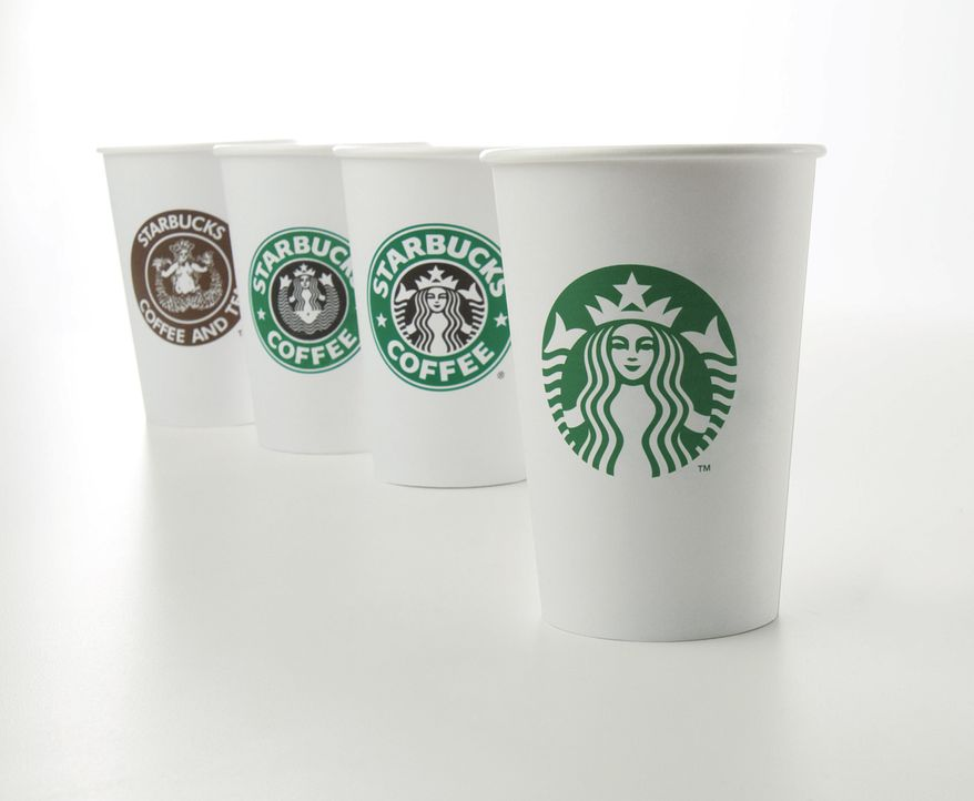 Starbucks unveiled its new logo (at right) on Wednesday, Jan. 5, 2011, marking the company's 40th anniversary. Other cups show the company's logo from over the years, from left, 1971, 1987 and 1992. (AP Photo/Starbucks)
