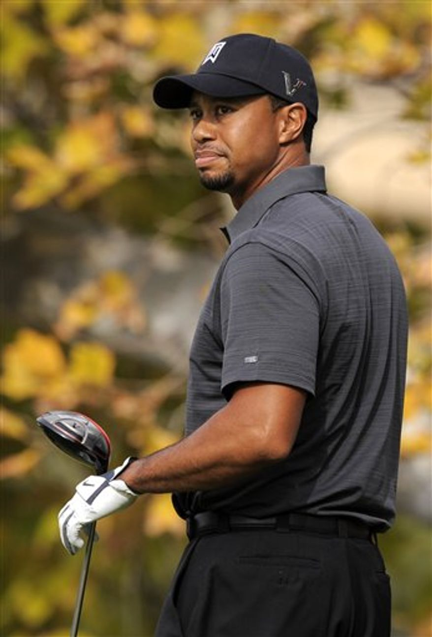 FILE - In this Dec. 3, 2011, file photo, Tiger Woods looks on after teeing off on the fifth hole during the second round of the Chevron World Challenge golf tournament at Sherwood Country Club in Thousand Oaks, Calif. Golf Digest and Woods announced the mutual end to their 13-year business relationship. It was the second-longest endorsement for Woods behind Nike. (AP Photo/Mark J. Terrill, File)