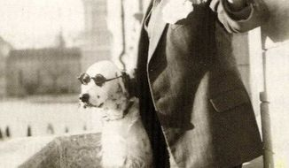 The undated photo taken from a book on the history of Finnish Tamro Group shows Tor Borg and his dog Jackie. The dog was dubbed Hitler by Borg's wife as it raised its paw for the Nazi salute. The Nazis started an investigation against the dog's owner, a 41-year-old wholesale merchant in Finland. (AP Photo/Tamro Group image bank)