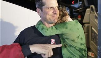 Stanford coach Jim Harbaugh arrives at the Stanford University campus with his daughter, Addison, as Stanford women's basketball coach Tara VanDerveer, right, looks on in Stanford, Calif., Tuesday, Jan. 4, 2011, the day after Stanford defeated Virginia Tech in the Orange Bowl NCAA college football game. (AP Photo/Paul Sakuma)