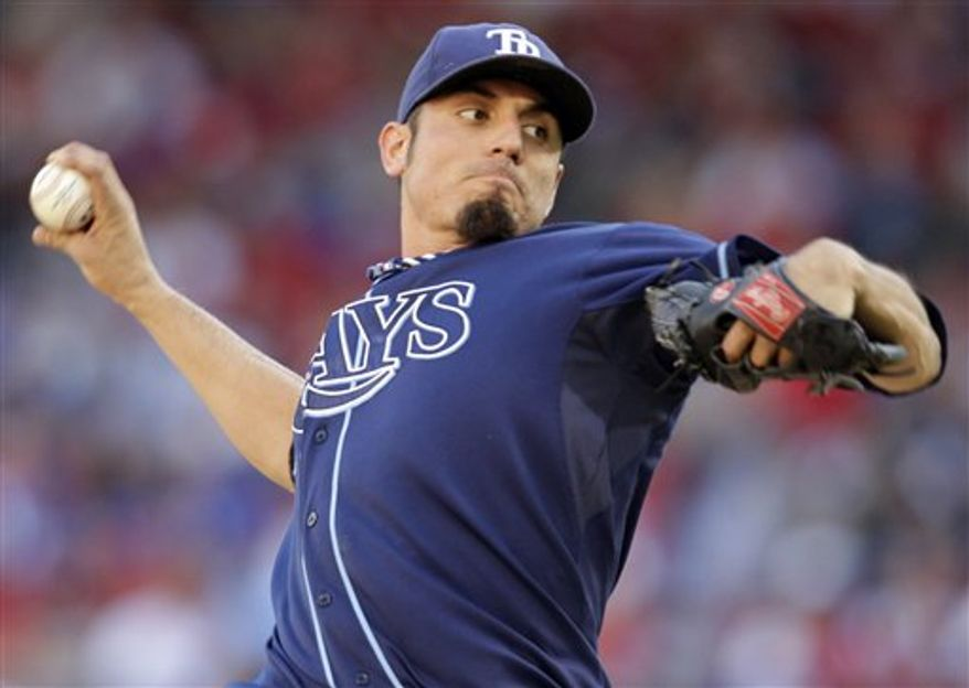 FILE - In this Sept. 30, 2010, file photo, Tampa Bay Rays starting pitcher Matt Garza throws during the first inning of a baseball game against the Kansas City Royals in Kansas City, Mo. The Chicago Cubs have a tentative trade in place to obtain Garza from the Rays, according to two people familiar with the negotiations.  The Rays would receive outfielder Sam Fuld, minor league outfielder Brandon Guyer and several other prospects for Garza, who would be sent to Chicago along with prospects, the two people told The Associated Press on Friday, Jan. 7, 2011. (AP Photo/Charlie Riedel, File)