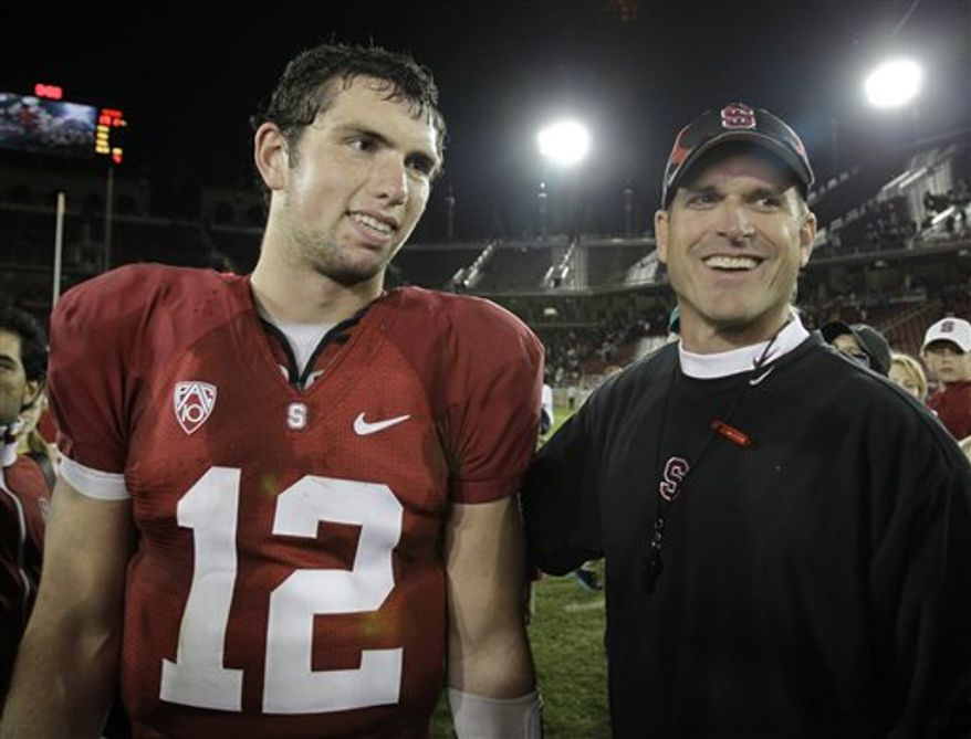 In this Nov. 6, 2010, photo, Stanford coach Jim Harbaugh and quarterback Andrew Luck (12) stand on the field after an NCAA college football game against Arizona in Stanford, Calif. Luck has decided to stay in college to get his degree instead of immediately cashing in on the riches of being the likely No. 1 pick in the NFL draft. He announced his decision Thursday, Jan. 6, 2011. (AP Photo/Paul Sakuma)