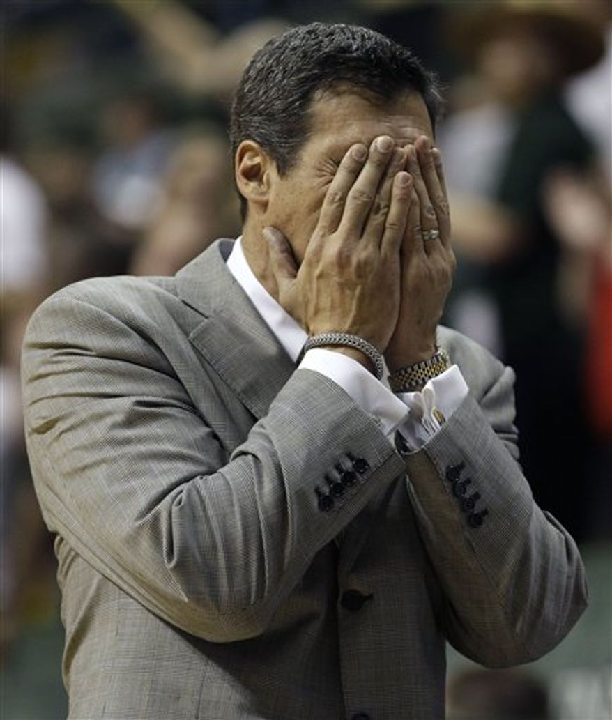 Villanova head coach Jay Wright covers his face after his team committed a second half foul against South Florida during an NCAA college basketball game, Thursday, Jan. 6, 2011, in Tampa, Fla. (AP Photo/Chris O'Meara)
