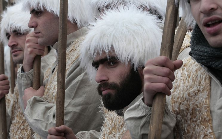 Men dressed as shepherds take part in a religious procession to mark the Orthodox Christmas in Tbilisi, Georgia, Friday, Jan. 7, 2011. Georgians celebrate Christmas on January 7, according to the Julian calendar used by the country's Orthodox church. (AP Photo/Shakh Aivazov)