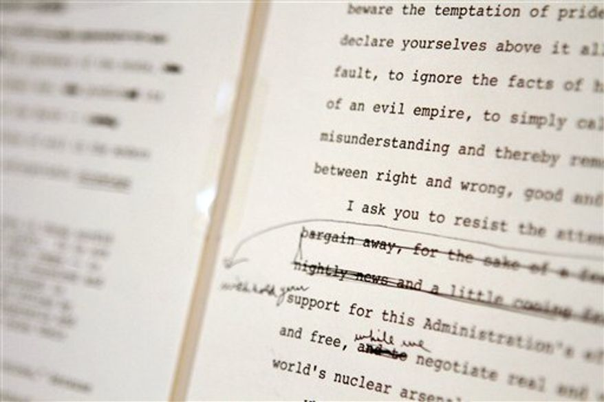 "A page of President Reagan's ""Evil Empire"" speech with his hand-written edits are seen at the National Archive in Washington, Wednesday, Jan. 5, 2011, as part of a press preview of rarely displayed original documents and artifacts in recognition of the Ronald Reagan Centennial. (AP Photo/Jacquelyn Martin)"
