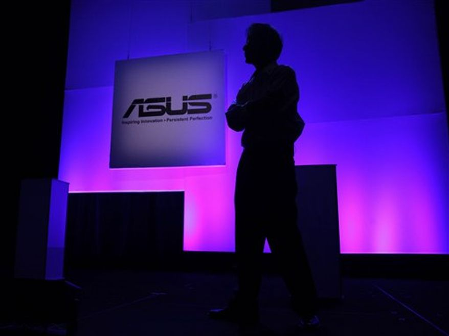 Asus International CEO Jonney Shih presents the Eee Pad Transformer, one of the company's newest tablets, at a press event for the Consumer Electronics Show, Tuesday, Jan. 4, 2011 in Las Vegas. CES officially starts on Thursday and runs through Sunday. (AP Photo/Julie Jacobson)