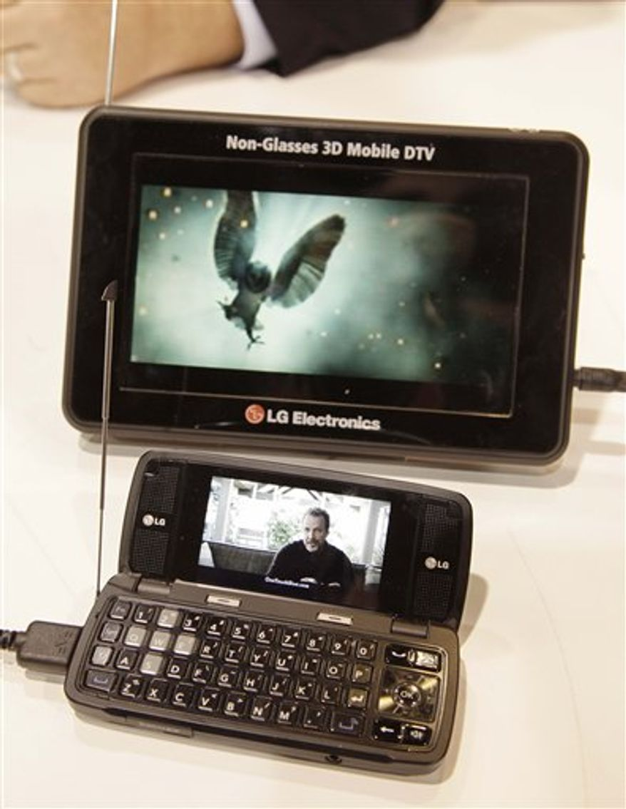 An iPhone, fitted with a Tivizen mobile digital television receiver plays a live newscast at the International Consumer Electronics Show, Friday, Jan. 7, 2011 in Las Vegas. (AP Photo/Julie Jacobson)