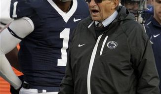 FILE - In this Nov. 6, 2010, file photo, Penn State coach Joe Paterno, right, walks past quarterback Rob Bolden (1) on the sidelines during an NCAA college football game against Northwestern in State College, Pa. Bolden's father says Paterno has denied his son's request to transfer. Robert Bolden Sr. said he wasn't expecting Paterno to turn down the quarterback after a meeting Tuesday, Jan. 4, 2011, in State College. It's unclear what Bolden will do next, with spring semester classes starting Monday. (AP Photo/Gene J. Puskar, File)
