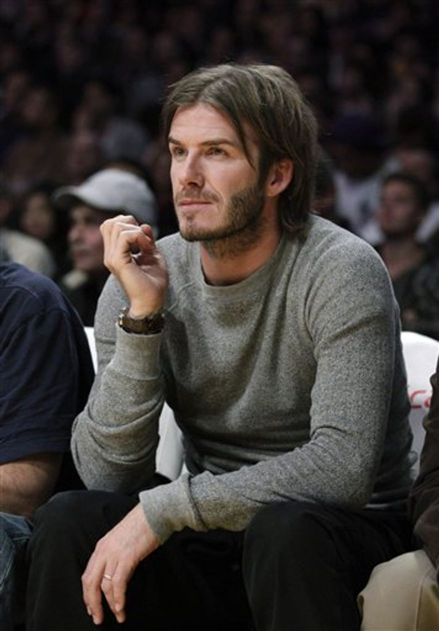 Soccer player David Beckham watches an NBA basketball game between the Los Angeles Lakers and the Detroit Pistons in Los Angeles, \Tuesday, Jan. 4, 2011. (AP Photo/Jae C. Hong)
