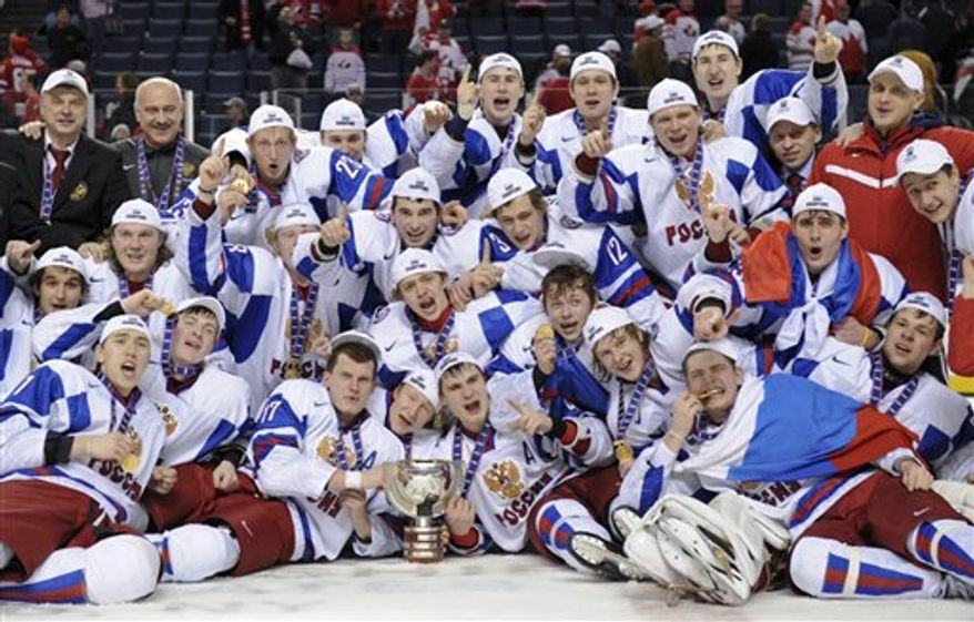 Team Russia forward Vladimir Tarasenko hoists the trophy after defeating Team Canada at the IIHF World Junior Championship gold medal final in Buffalo, N.Y. on Wednesday, Jan. 5, 2011. (AP Photo/The Canadian Press,Nathan Denette)