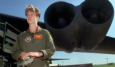 Lt. Kelly Flinn, the nation's first female bomber pilot, stands near  the wing of a B-52 at Barksdale Air Force Base in Bossier, La., April  21, 1995. (Photo: Associated Press)