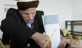 A Kosovo man casts his ballot at a polling station in the village of Zabelj in central Kosovo on Sunday. (Associated Press)