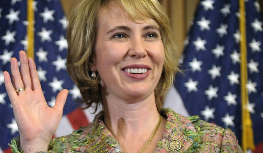 Rep. Gabrielle Giffords, Arizona Democrat, takes part in a re-enactment of her swearing-in on Capitol Hill in Washington on Wednesday, Jan. 5, 2011. (AP Photo/Susan Walsh)
