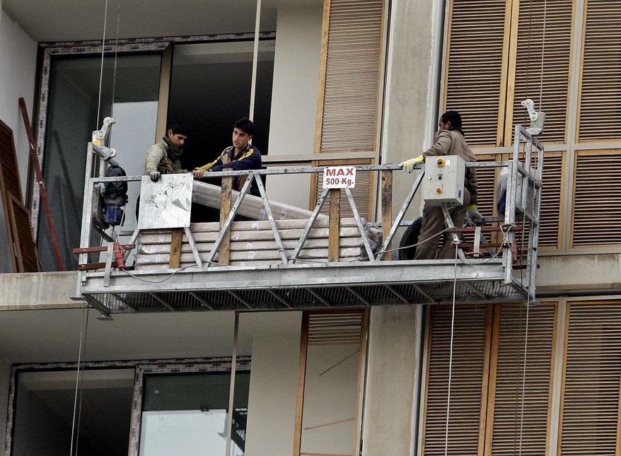 Workers make repairs to the Sheraton Hotel in central Baghdad on Sunday, Jan. 9, 2011. Insurgent threats and a lack of space in hotels being rebuilt from bombings have cast doubt on whether the Arab League can hold its annual meeting in Iraq this spring. Iraqi and league officials maintain the March 23 summit will take place as planned. (AP Photo/Hadi Mizban)