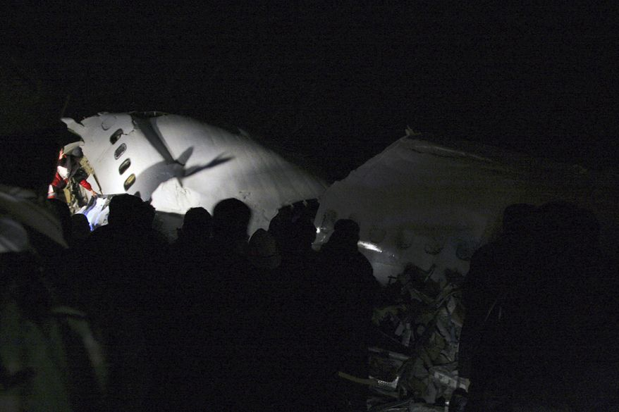 In this picture released by the Mehr news agency, wreckage of the IranAir Boeing 727 passenger plane is seen, which crashed Sunday after it was making an emergency landing, outside the city of Orumiyeh, 460 miles northwest of Tehran. An IranAir passenger jet carrying 106 people crashed as it was making an emergency landing Sunday in a snowstorm in the country's northwest and broke into several pieces, killing more than 70 of those on board, Iranian media reported. The others survived with light injuries. (Associated Press/Mehr News Agency, Esfandiar Asgharkhani)