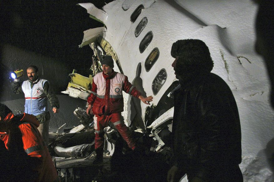 In this picture released by the Mehr news agency, rescue workers attend the scene Sunday after an IranAir Boeing 727 passenger plane crashed as it was making an emergency landing, outside the city of Orumiyeh, 460 miles northwest of Tehran. An IranAir passenger jet carrying 106 people crashed as it was making an emergency landing Sunday in a snowstorm in the country's northwest and broke into several pieces, killing more than 70 of those on board, Iranian media reported. The others survived with light injuries. (Associated Press/Mehr News Agency, Esfandiar Asgharkhani)