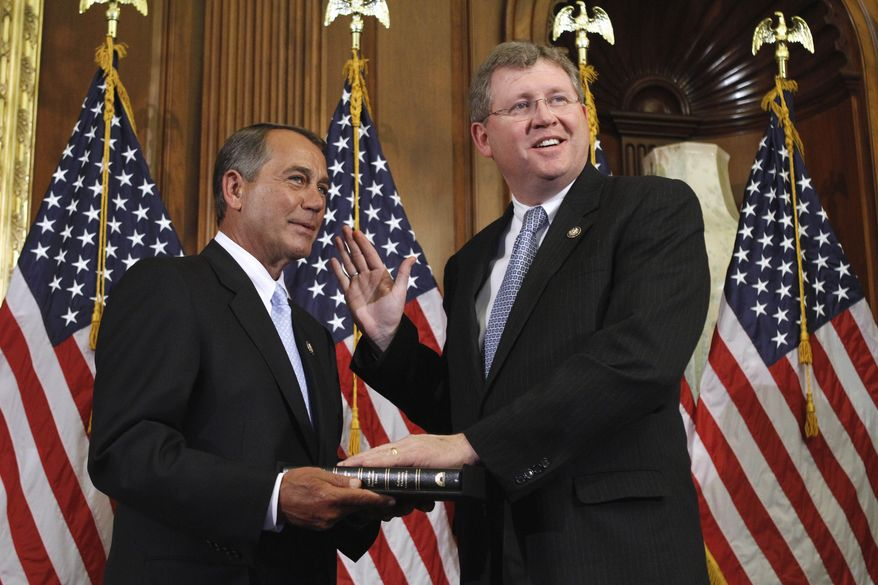 House Speaker John Boehner of Ohio administers the House oath to Rep. Frank Lucas, Oklahoma Republican, during a mock swearing-in ceremony Wednesday on Capitol Hill. (Associated Press)