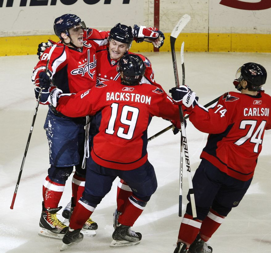 Washington Capitals' Alex Ovechkin, from left, celebrates his goal with teammates Karl Alzner, Nicklas Backstrom from Sweden, and John Carlson during third period of an NHL hockey game agains the Florida Panthers in Washington Saturday, Jan. 8, 2011. Washington won 3-2. (AP Photo/Manuel Balce Ceneta)