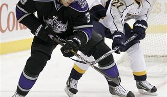 Los Angeles Kings defenseman Jack Johnson, left, collides with Nashville Predators center Nick Spaling during the first period of an NHL hockey game in Los Angeles, Thursday, Jan. 6, 2011. (AP Photo/Chris Carlson)