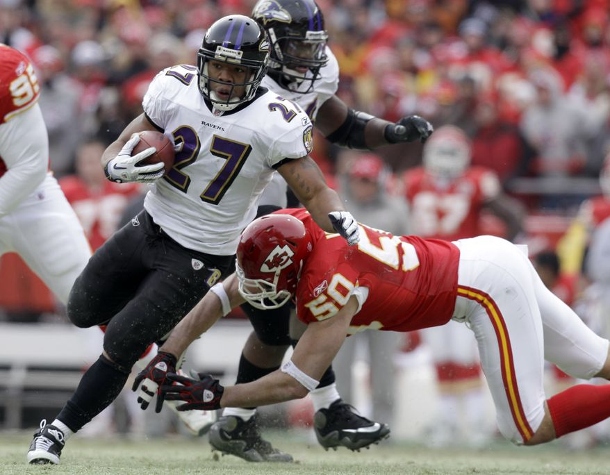 Baltimore Ravens running back Ray Rice gets past Kansas City Chiefs linebacker Mike Vrabel during the first quarter of an NFL AFC wild card football playoff game Sunday, Jan. 9, 2011, in Kansas City, Mo. (AP Photo/Jeff Roberson)