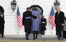 President Obama and first lady Michelle Obama depart after joining government employees on the South Lawn of the White House to observe a moment of silence for victims of shooting rampage in Arizona. (Associated Press)