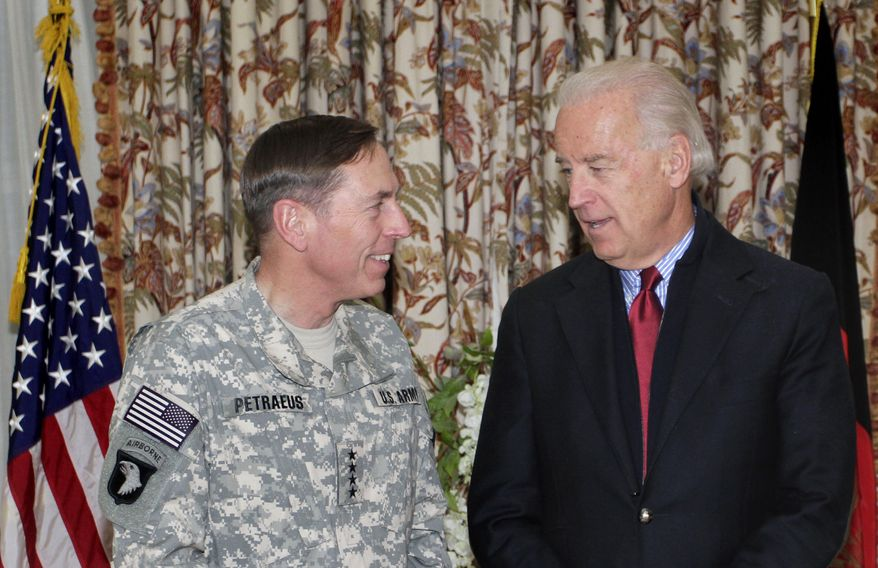 Vice President Joseph R. Biden Jr. (right) speaks with Gen. David H. Petraeus, the top U.S. and NATO commander in Afghanistan, during a press event in Kabul, Afghanistan, on Monday, Jan. 10, 2011. Mr. Biden is in Afghanistan on a surprise visit to assess progress in handing over security from foreign to Afghan forces. (AP Photo/Musadeq Sadeq)