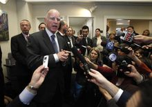 ** FILE ** California Gov. Jerry Brown talks to reporters on Jan. 4, his first full day in office, after meeting with members of the California State Association of Counties in Sacramento, Calif. (Associated Press)